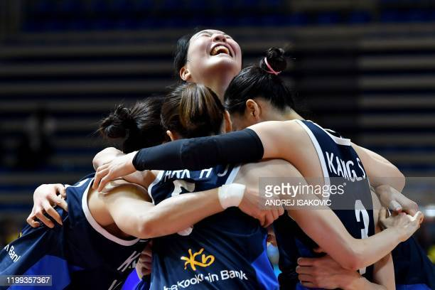 South Korea's players celebrate their victory after the FIBA Women's Olympic Qualifying basketball match between Great Britain and South Korea on...