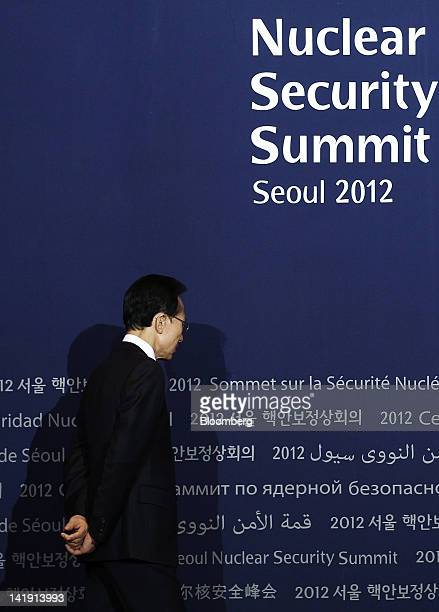 South Korea's president Lee Myung Bak waits for other countries' leaders during a photo session before the working dinner at the 2012 Seoul Nuclear...