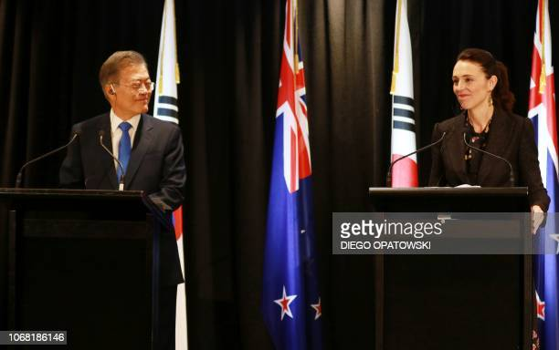 South Korea's President Moon Jaein amd New Zealand Prime Minister Jacinda Adern attend a joint press conference in Auckland on December 4 2018 North...