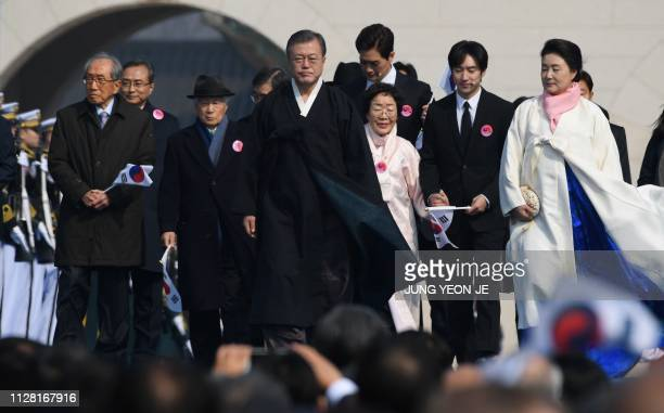 South Korea's President Moon Jaein and his wife Kim Jungsook attend a ceremony commemorating the 100th anniversary of the March First Independence...