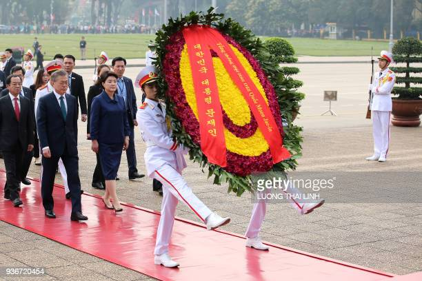 South Korea's President Moon Jaein and his wife Kim Jungsook attend a wreathlaying ceremony at the mausoleum of Vietnam's late president Ho Chi Minh...