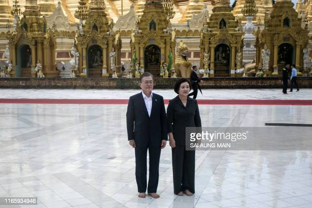 South Korea's President Moon Jae-in and his wife Kim Jung-sook pose for a photo as they visit Shwedagon pagoda in Yangon on September 4, 2019.