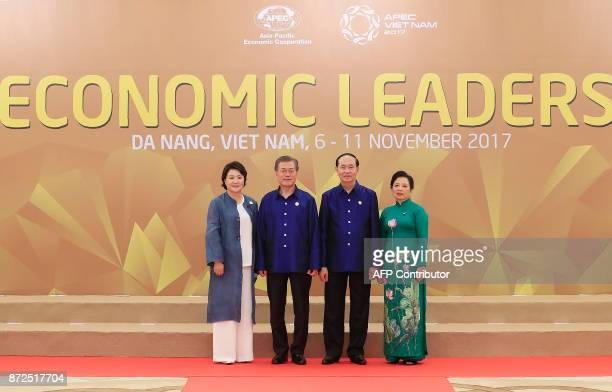 South Korea's President Moon JaeIn and his wife Kim Jungsook pose with Vietnams President Tran Dai Quang as his wife Nguyn Th Hin upon arrival for...