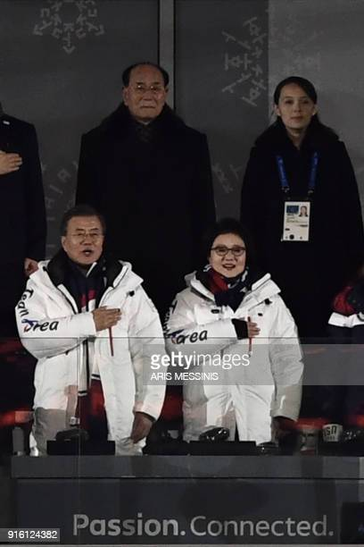 South Korea's President Moon Jaein and his wife Kim JungSuk observe South Korea's national anthem with VIP guests including North Korea's Kim Jong...