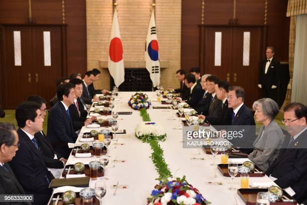 South Korea's President Moon Jaein and Japan's Prime Minister Shinzo Abe hold their luncheon meeting at the latter's former official residence in...