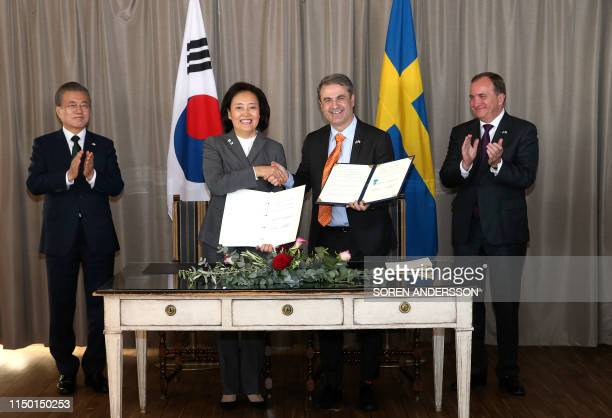 South Korea's President Moon Jae-in and Sweden's Prime Minister Stefan Lofven applaud as South Korean Startup Minister Park Young-Sun and Swedens...