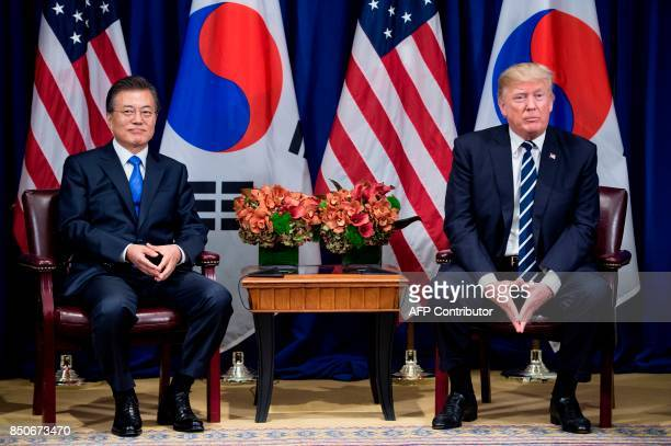 South Korea's President Moon Jaein and US President Donald Trump wait for a meeting at the Palace Hotel during the 72nd United Nations General...