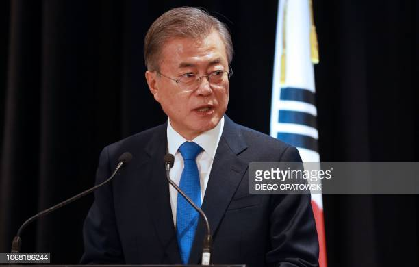 South Korea's President Moon Jaein attends a joint press conference in Auckland with New Zealand Prime Minister Jacinda Adern on December 4 2018...