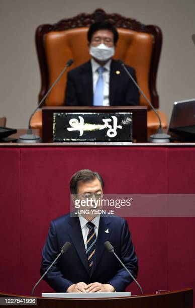 South Korea's President Moon Jaein delivers a speech as the National Assembly Speaker Park Byeongseug looks on during the opening ceremony of the...