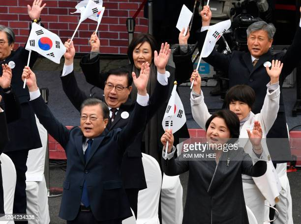 South Korea's President Moon Jaein gives three cheers during a ceremony to mark the 101th anniversary of the March 1st Independence Movement Day in...