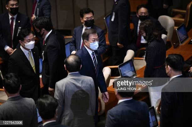 South Korea's President Moon Jaein leaves after a speech during the opening ceremony of the 21st National Assembly term in Seoul on July 16 2020