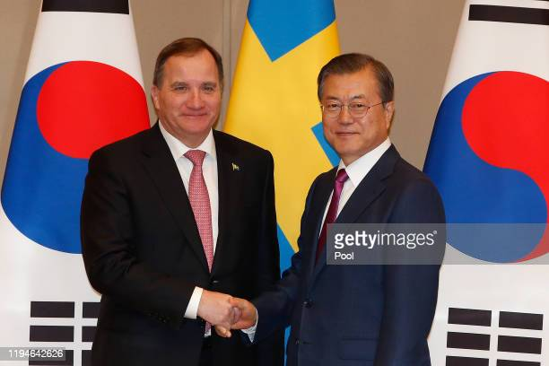South Korea's President Moon Jae-in shakes hands with Sweden's Prime Minister Stefan Lofven during their meeting at the presidential blue house on...