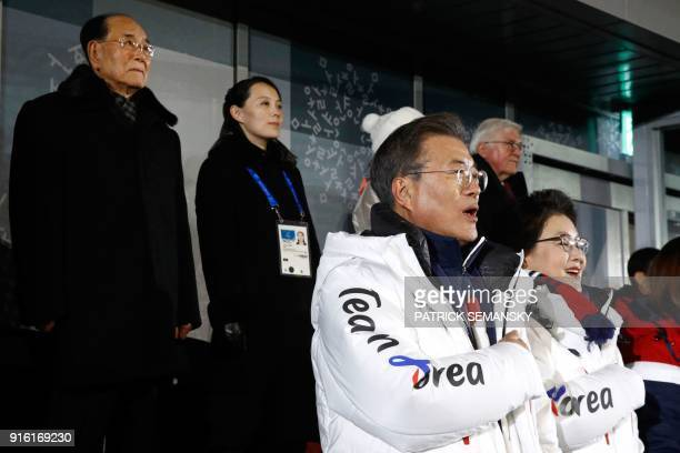 TOPSHOT South Korea's President Moon Jaein sings the South Korean national anthem with his wife Kim Jungsook in front of North Korea's ceremonial...