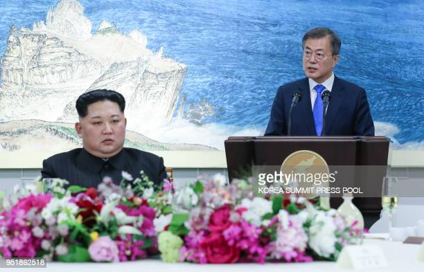 South Korea's President Moon Jaein speaks as North Korea's leader Kim Jong Un listens to during the official dinner at the end of their historic...
