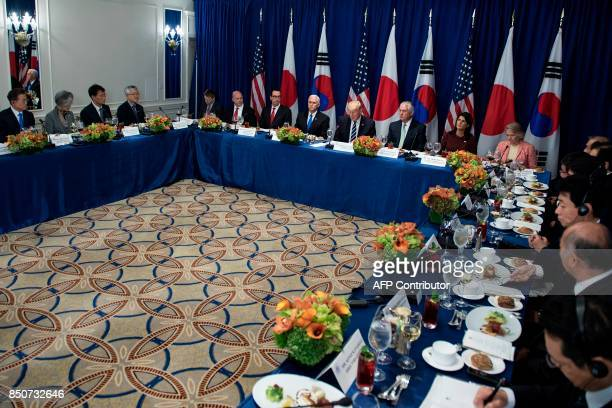South Korea's President Moon Jae-in, US President Donald Trump, Japan's Prime Minister Shinzo Abe, and others wait for a luncheon with US, Korean,...
