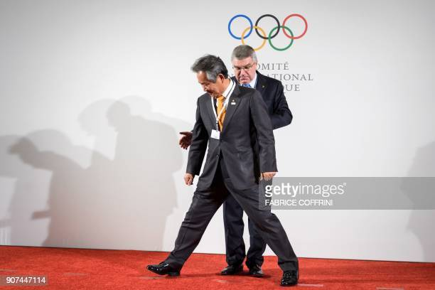 South Korea's President of the National Olympic Committee Lee Keeheung moves for a picture in front of International Olympic Committee President...