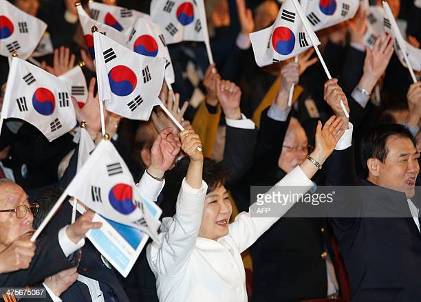 South Korea's President Park Geunhye cheers during a ceremony celebrating the 95th anniversary of the March First Independence Movement against...