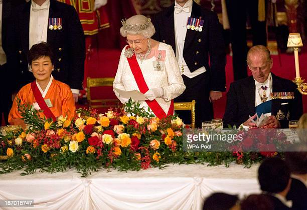 South Korea's President Park Geunhye listens as Britain's Queen Elizabeth II makes a speech a state banquet at Buckingham Palace on November 5 2013...