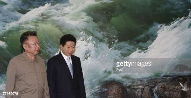 South Korea's President Roh MooHyun and North Korea's leader Kim JongIl talks at the interKorean summit on October 3 2007 in Pyongyang North Korea...