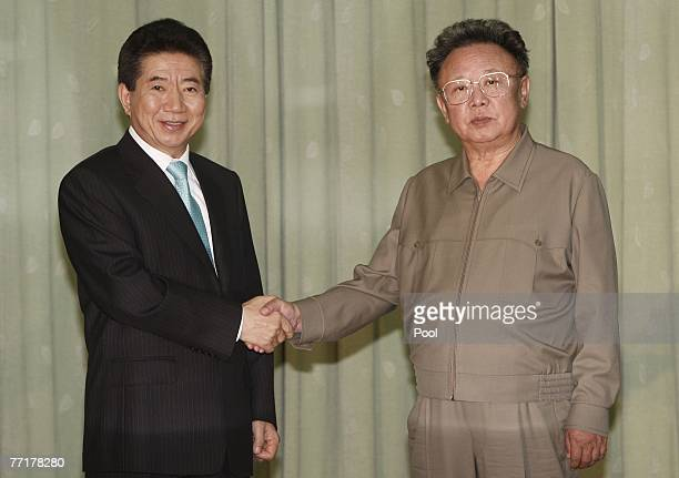 South Korea's President Roh Moo-Hyun and North Korea's leader Kim Jong-Il shake hands after they exchanged their joint statement on October 4, 2007...
