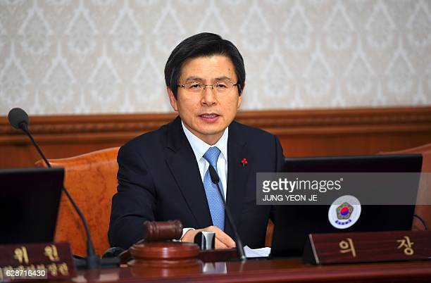 South Korea's Prime Minister and acting President Hwang KyoAhn speaks during a Cabinet meeting at the government complex in Seoul on December 9 2016...