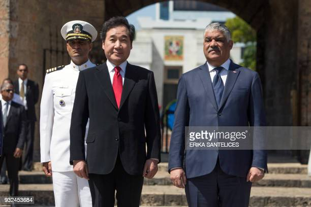South Korea's Prime Minister Lee Nakyeon and Dominican Foreign Minister Miguel Vargas Maldonado are pictured during a wreathlaying ceremony to pay...