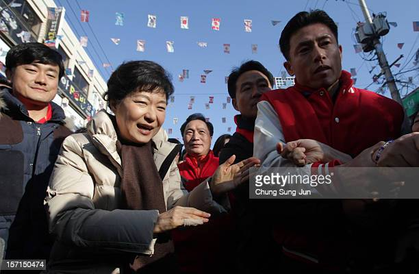 South Korea's ruling Saenuri Party's presidential candidate, Park Geun-Hye, takes to downtown streets as she begins her presidential election...
