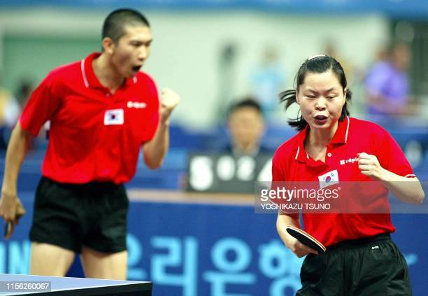South Korea's Ryu JiHae and Ryu SeungMin celebrate as the win a key point against North Korea's Kim songChol and Kim HyonHui during the mixed doubles...