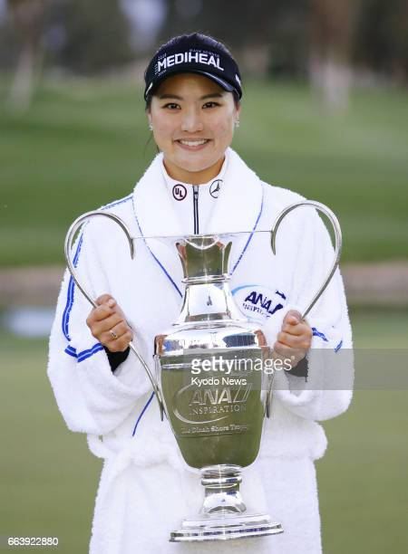 South Korea's Ryu So Yeon holds the winner's trophy for the ANA Inspiration golf tournament at Mission Hills Country Club in Rancho Mirage California...