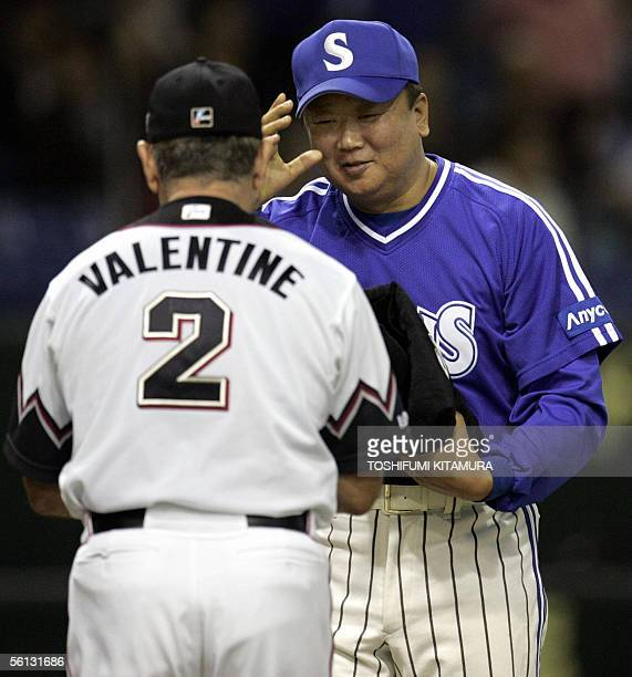 South Korea s Samsung Lions team manager Sun DongYol greets Japan s Chiba  Lotte Marines team mangager Bobby 9dc21d40eb4e