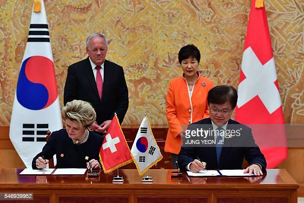 South Korea's Science, ICT and Future Planning Minister Choi Yang-Hee and Swiss State Secretary for Economic Affairs Marie-Gabrielle Ineichen-Fleisch...