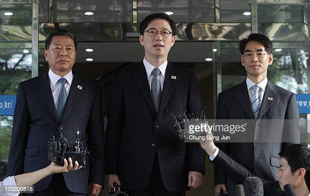 South Korea's senior Unification Ministry official and head of workinglevel delegation Chun HaeSung speaks with delegates Kwon YoungYang and Kang...