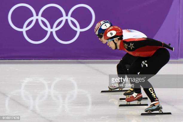 South Korea's Seo Yira and China's Han Tianyu take part in the men's 1,500m short track speed skating B final event during the Pyeongchang 2018...