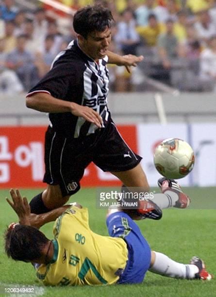 South Korea's Seongnam Ilhwa players Shin Tae-Yong and Turkey's Besiktas JK player Daniel Gabriel Pancu fight for the ball during the Peace Cup Korea...