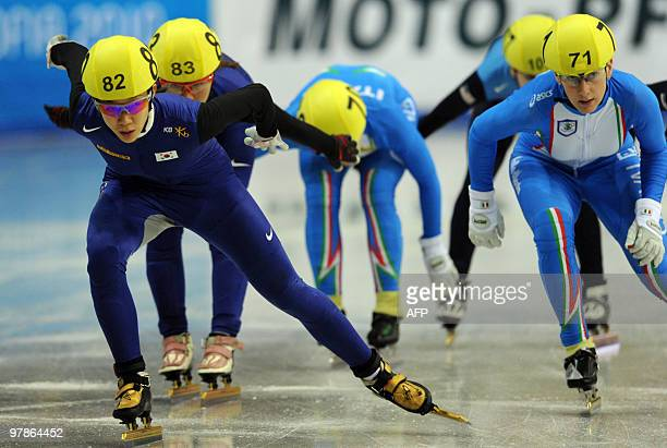 South Korea's Seung Hi Park pushes teammate Ha Ri Cho next to Italy's Cecilia Maffei in the Women's Short Track Speedskating 3000 m Relay semifinal...
