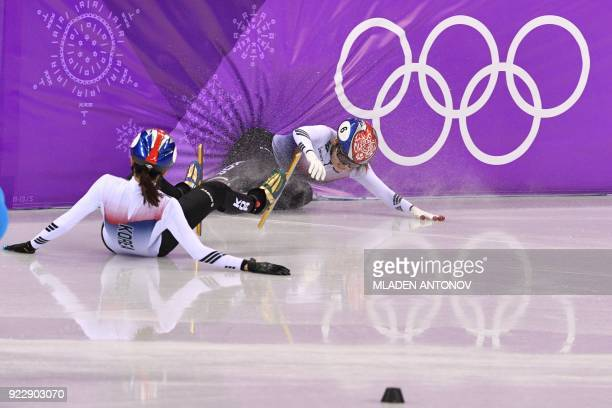 TOPSHOT South Korea's Shim Sukhee and South Korea's Choi Minjeong crash during the women's 1000m short track speed skating A final event during the...