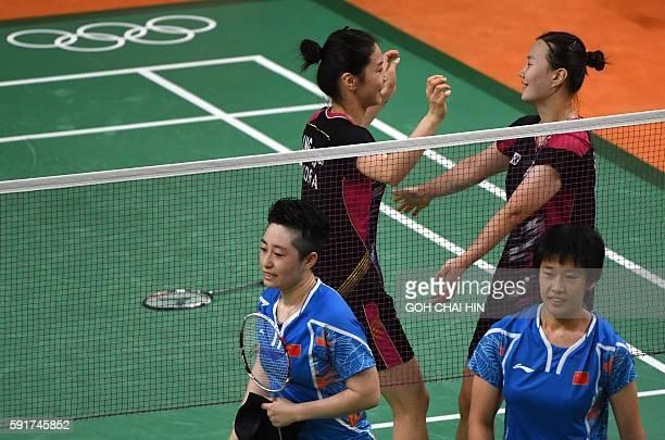 South Korea's Shin Seung Chan and South Korea's Jung Kyung Eun react after winning against China's Tang Yuanting and China's Yu Yang during their...