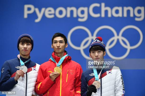 South Korea's silver medallist Hwang Daeheon China's gold medallist Wu Dajing and South Korea's bronze medallist Lim Hyojun pose on the podium during...