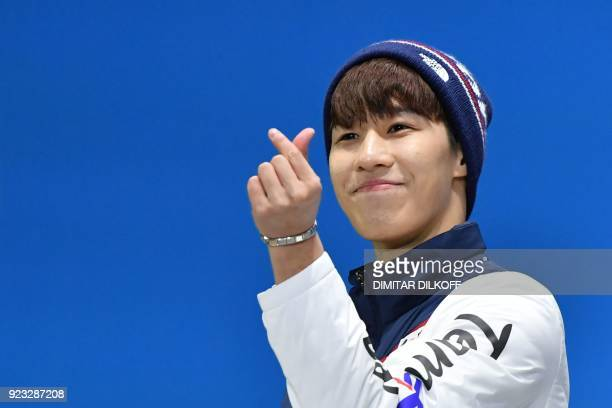 South Korea's silver medallist Hwang Daeheon poses on the podium during the medal ceremony for the short track Men's 500m at the Pyeongchang Medals...