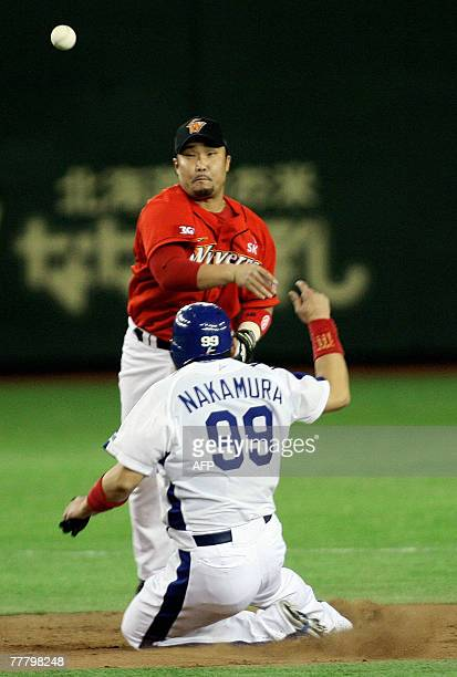 South Korea's Sk Wyverns second baseman Chung KyoungBae throws a ball to first after forcing out Japan's Chunichi Dragons Norihiro Nakamura on the...