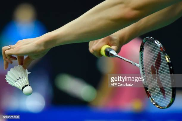 South Korea's Son Wan Ho prepares to serve during his preliminary round men's singles match against Finland's Kalle Koljonen during the 2017 BWF...