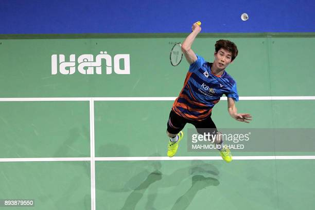 South Korea's Son Wan Ho returns a shot to Malaysia's Lee Chong Wei during their semifinal match during the Dubai Badminton World Superseries Finals...