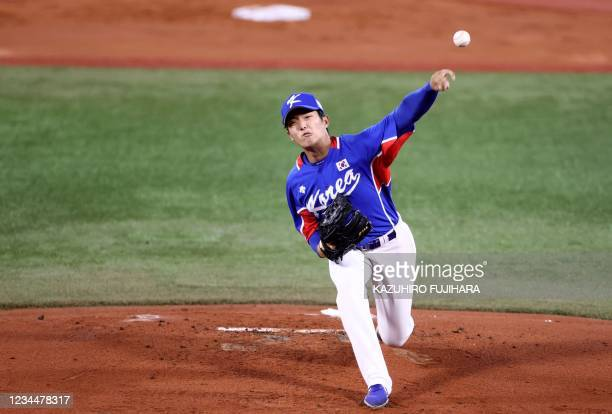 South Korea's starting pitcher Lee Euilee hurls the ball during the first inning of the Tokyo 2020 Olympic Games baseball semifinal game between...