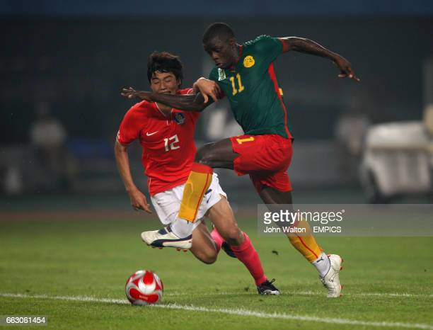 South Korea's Sung Yueng Ki and Cameroon's Gustave Bebbe