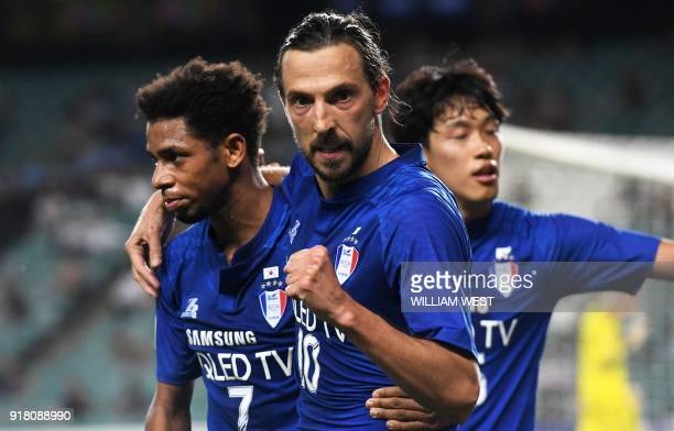 South Korea's Suwon Bluewings player Dejan Damjanovic celebrates with teammates after scoring against Australia's Sydney FC during their AFC...