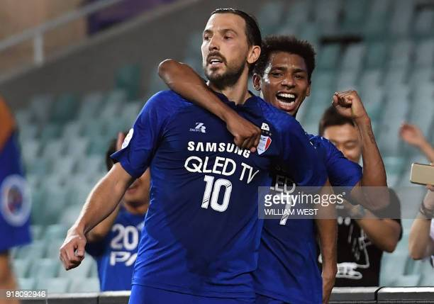 South Korea's Suwon Bluewings player Dejan Damjanovic celebrates with teammate Wagner Da Silva Souza after scoring against Australia's Sydney FC...