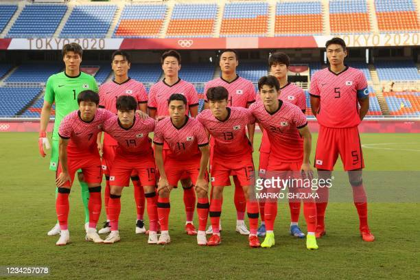 South Korea's team poses during the Tokyo 2020 Olympic Games men's group B first round football match between South Korea and Honduras at the...