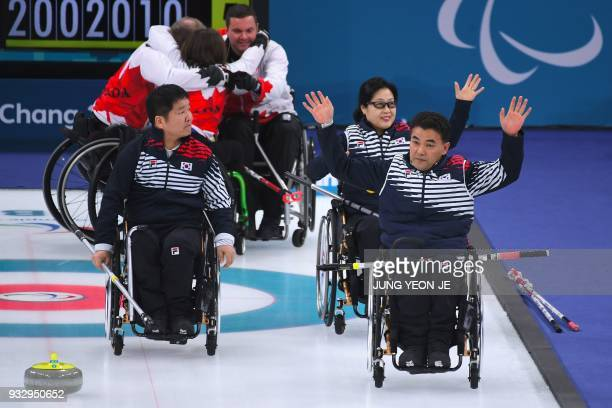 South Korea's team waves to the crowd after losing the wheelchair curling bronze medal game to Canada at the Gangneung Curling Centre during the...