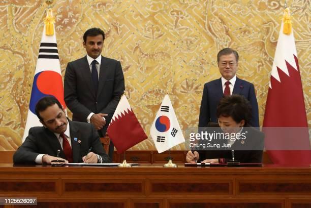 South Korea's Transport Minister Kim Hyun-mee and Qatar foreign minister Sheikh Mohammed bin Abdulrahman Al-Thani sign a document as South Korean...