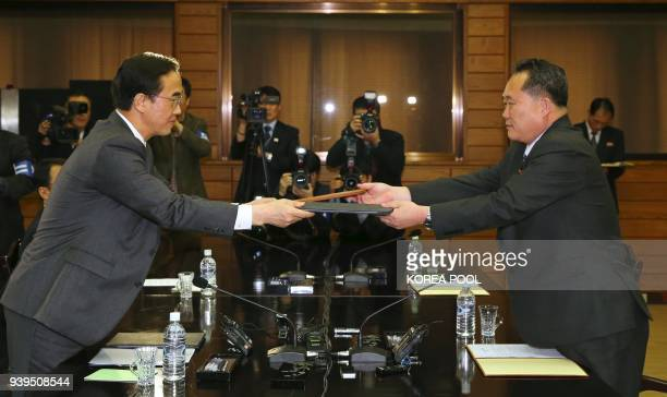 South Korea's Unification Minister Cho Myounggyun and his North Korean counterpart Ri Son Gwon who is chairman of the North's Committee for the...